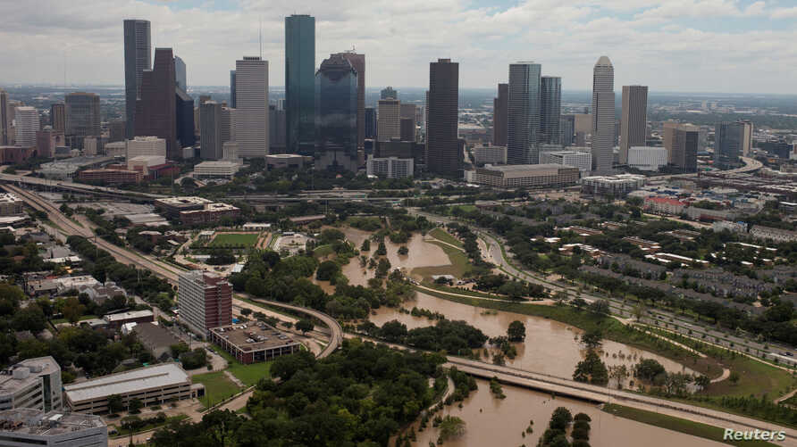The Houston skyline is seen in the background as Buffalo Bayou is seen flooded from Tropical Storm Harvey in Texas, Aug. 30, 2017.