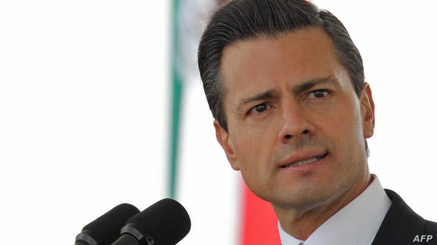 Mexican President Enrique Pena Nieto speaks during the ceremony of the National Flag day in Frontera city, Coahuila state, Mexico, Feb. 24, 2014.  (Photo credit: Presidencia / Julio Cesar Hernandez / Handout)
