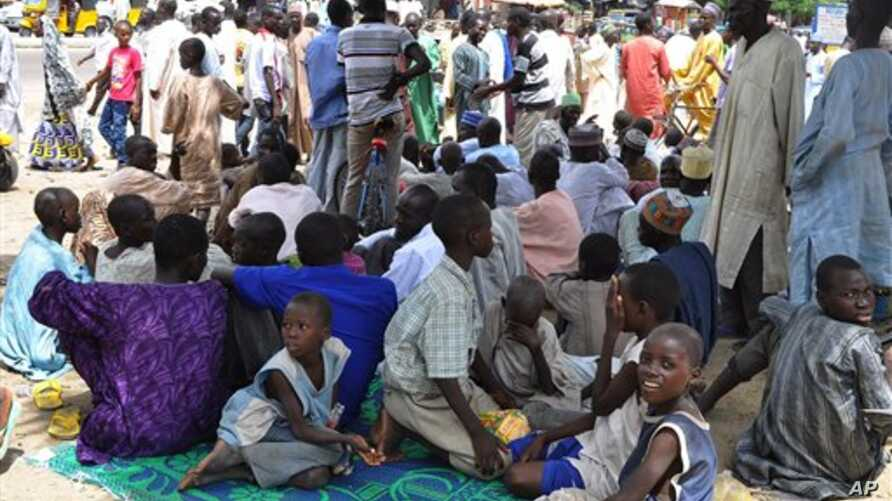 Civilians who fled their homes following an attacked by Islamist militants in Bama, take refuge at a School in Maiduguri, Nigeria, Wednesday, Sept. 3, 2014. A Nigerian senator says thousands of people are fleeing a northeastern city amid conflicting