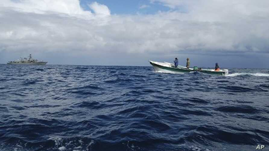 Local fishermen help the Chilean Navy in the search and recovery of the victims of a plane crash in the waters of the Juan Fernandez islands, September 3, 2011
