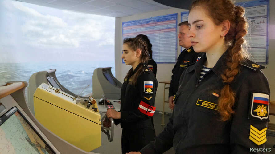 Naval cadet Alina Politika, right, takes part in a training on the captain's bridge simulator at N. G. Kuznetsov Naval Academy's department in Kaliningrad, Russia March 5, 2019.