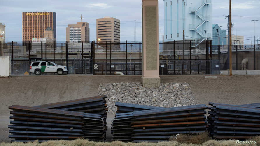 FILE - A U.S. Customs and Border Protection (CBP) vehicle is driven along a fence in El Paso, Texas, U.S., in this picture taken from Ciudad Juarez, Mexico, Feb. 14, 2019.