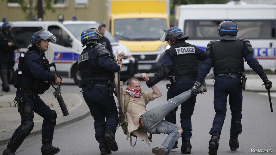 French police apprehend a man during a demonstration to protest the government's proposed labour law reforms in Nantes, France, May 26, 2016.