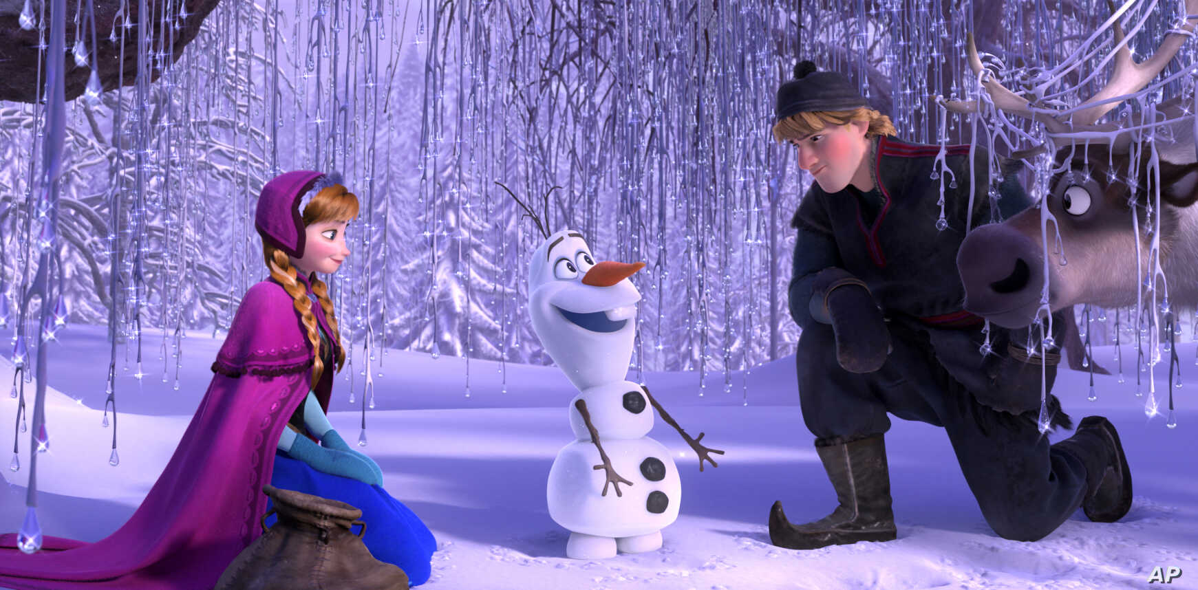 """This image released by Disney shows, from left, Anna, voiced by Kristen Bell, Olaf, voiced by Josh Gad, and Kristoff, voiced by Jonathan Groff in a scene from the animated feature """"Frozen."""" (Disney)"""