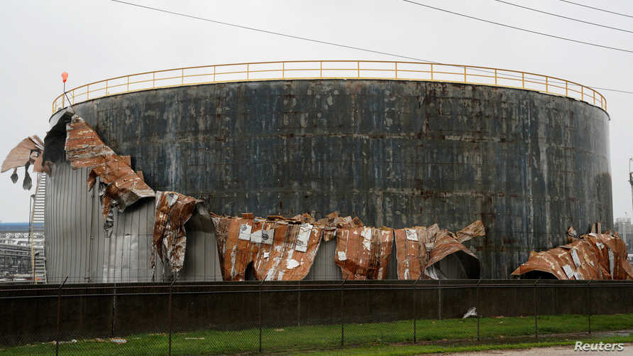 An oil tank damaged by Hurricane Harvey is seen near Seadrift, Texas, August 26, 2017.