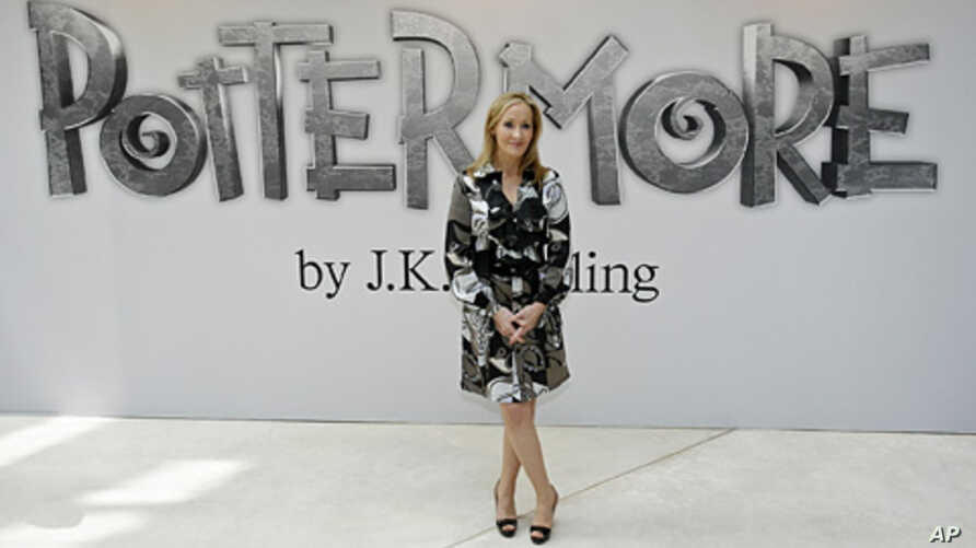 British author J.K. Rowling poses for photographers as she announces her new website project Pottermore at the Victoria and Albert Museum in London, June 23, 2011