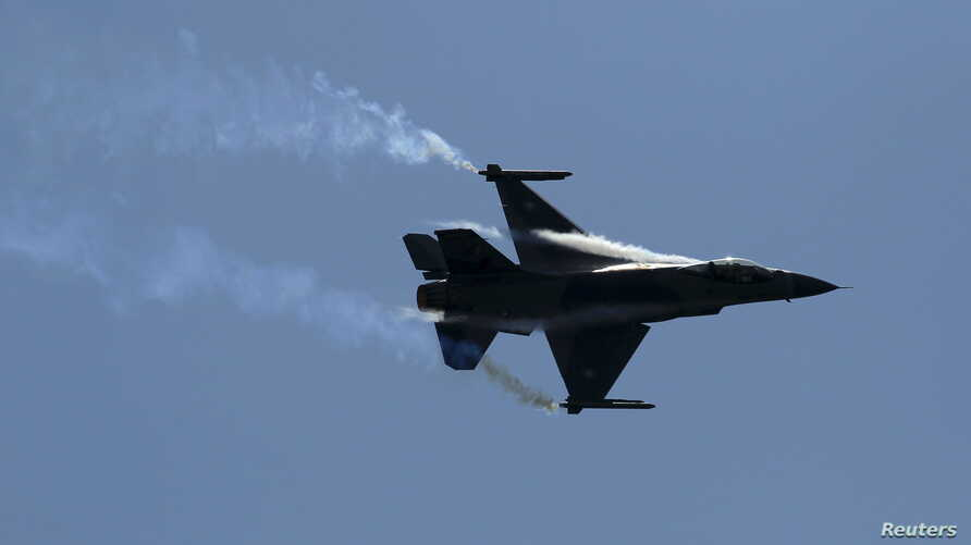 FILE - A Pakistani F-16 fighter performs during a ceremony marking Pakistan Defence Day in Islamabad, Pakistan.