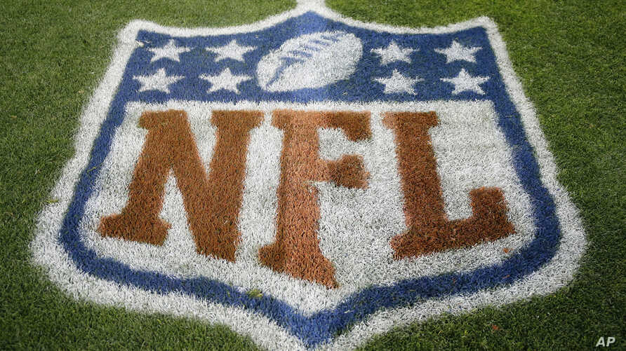 FILE - An NFL logo is displayed on the field before an NFL football game between the New England Patriots and the Denver Broncos in Denver, Nov. 12, 2017. Fox and the NFL have agreed to a five-year deal for Thursday night football games, Fox announce