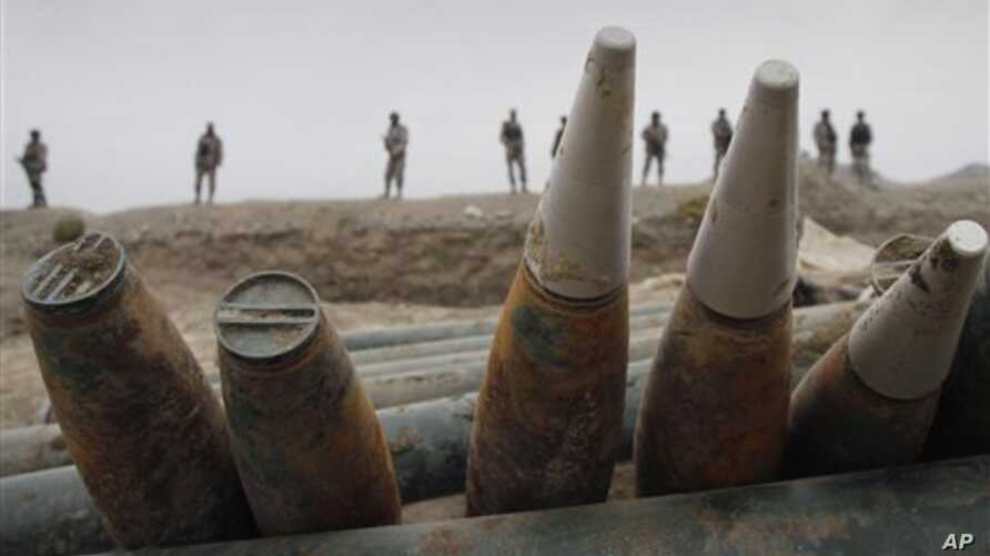Afghan border policemen discovered a cache of ammunitions and missiles at a weapons cache in Goshta district, Nangarhar province, east of Kabul, Afghanistan, police officials said, January 14, 2012.