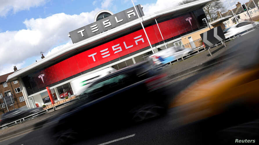 FILE - A Tesla car showroom is seen in west London, Britain, March 21, 2017.