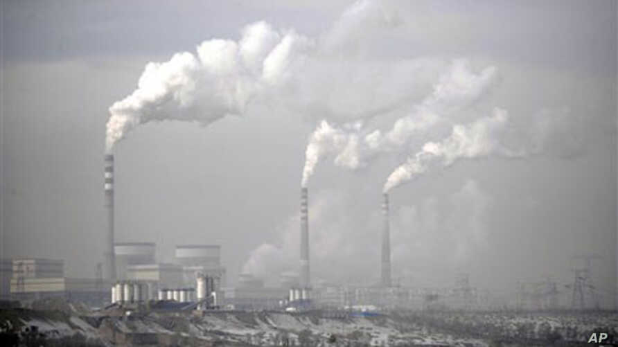 Smokes billows from chimneys of the cooling towers of a coal-fired power plant in Dadong, Shanxi province, China (file photo)