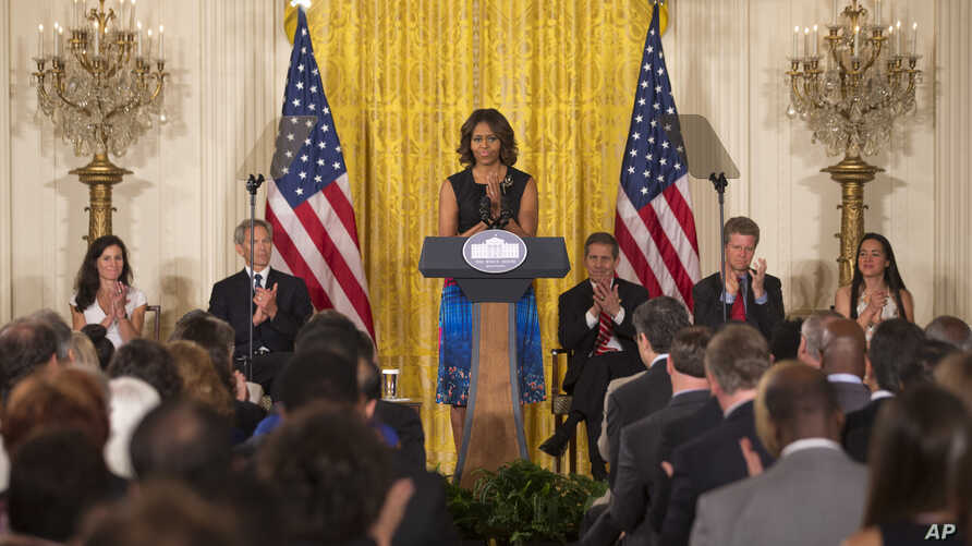 """First lady Michelle Obama speaks at a Joining Forces initiative event to announcing """"The Mayors Challenge to End Veteran Homelessness"""" program, in the East Room of the White House in Washington, June 4, 2014."""