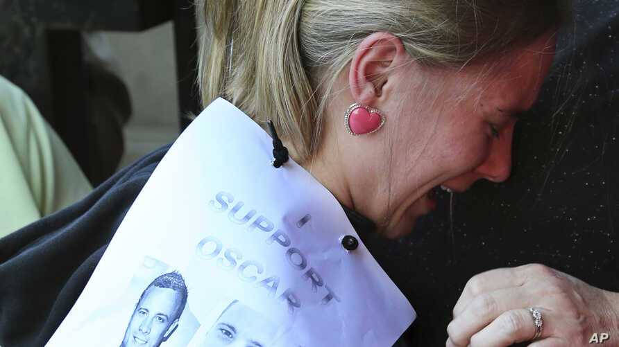 Emotional Kayla Nolan, left, is comforted by her mother Lynette Nolan after meeting Oscar Pistorius upon his arrival at the high court in Pretoria, South Africa, Monday, May 5, 2014. Pistorius' murder trial enters a critical phase Monday as his defen