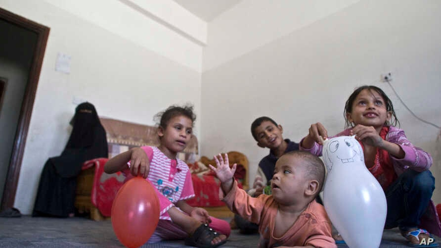 Displaced children play in a room in a school, where they are living with their family, who fled after a Saudi-led airstrike destroyed their houses, in Sana'a, Yemen, May 14, 2015.