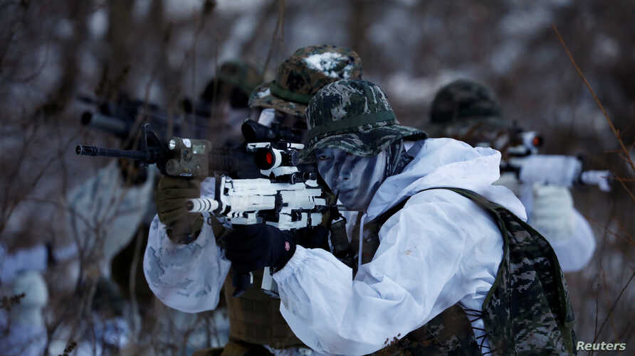 South Korean and U.S. Marines participate in a winter military drill in Pyeongchang, South Korea, Jan. 24, 2017.