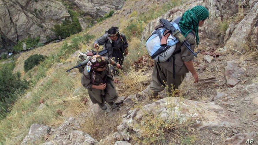FILE - Rebels of the Kurdistan Workers Party [PKK] are seen in Turkey near the border with Iraq, May 2013.