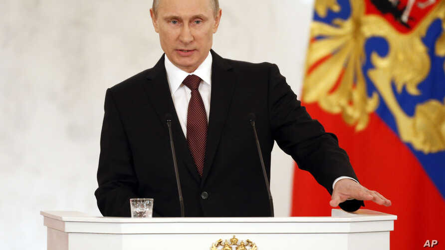 Russia's President Vladimir Putin addresses the Federation Council in Moscow's Kremlin on Tuesday, March 18, 2014. Putin defended Russia's move to annex Crimea, saying that the rights of ethnic Russians have been abused by the Ukrainian government.