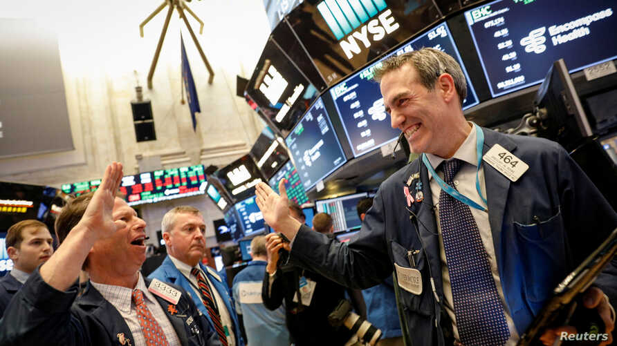 Traders celebrate after the closing bell on the floor of the New York Stock Exchange, (NYSE) in New York, Feb. 6, 2018.