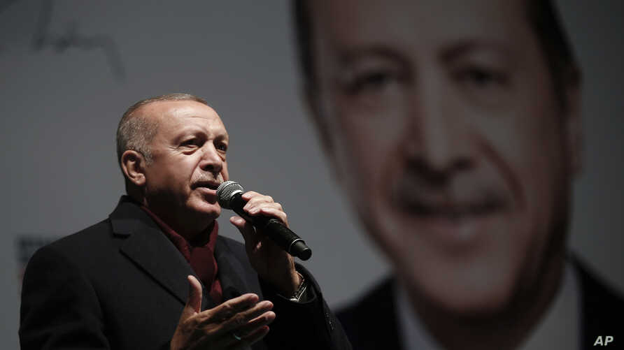 Turkey's President Recep Tayyip Erdogan addresses the supporters of his ruling Justice and Development Party, AKP, at a rally in Istanbul, March 19, 2019.
