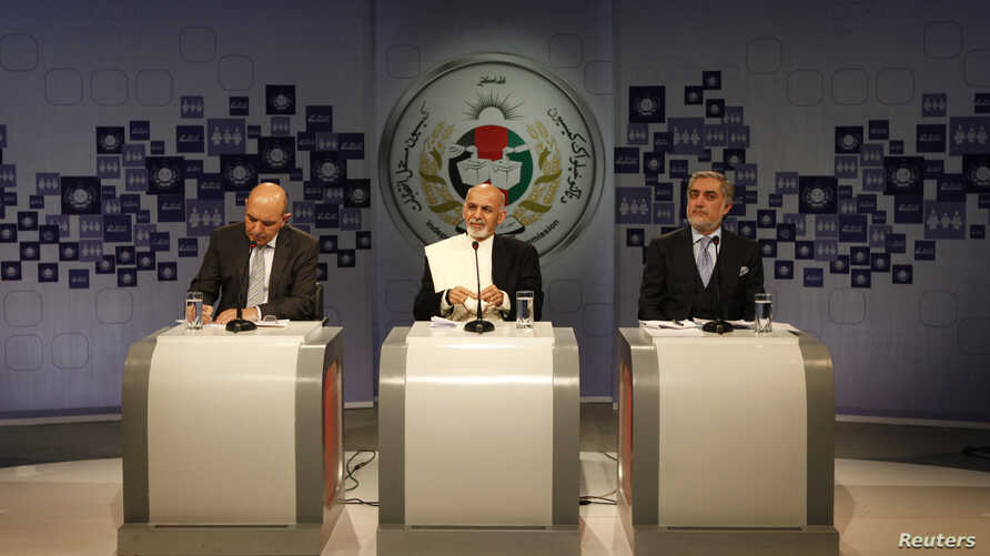 Afghan presidential candidate Ashraf Ghani Ahmadzai (C) speaks as candidates Abdullah Abdullah (R) and Qayum Karzai (L) listen during the presidential election debate at the studio of a local TV channel in Kabul, Feb. 8, 2014.