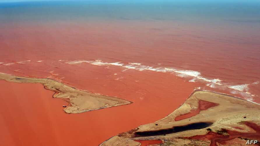 Handout picture released by the Espirito Santo State Press Office showing an aerial view of the Doce River--which was flooded with toxic lama after a dam owned by Brazilian Vale SA and Australian BHP Billiton Ltd burst early this month-- flowing into