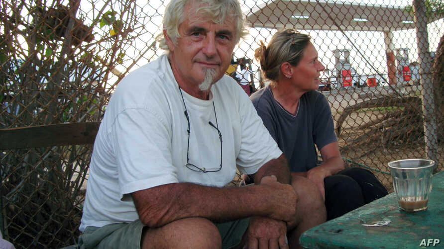FILE - German national Jurgen Kantner and his wife Sabine Merz (R) pose for a photograph on May 05, 2009 in Berbera, Somaliland.
