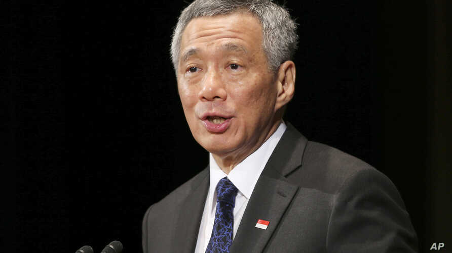 FILE - Singapore Prime Minister Lee Hsien Loong delivers a keynote speech at the 20th International Conference on The Future of Asia in Tokyo, May 22, 2014.