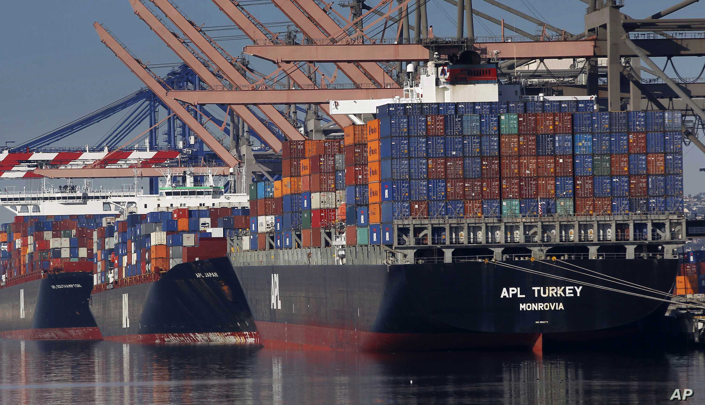 FILE - Container ships are seen docked at the Port of Los Angeles, Feb. 23, 2015.
