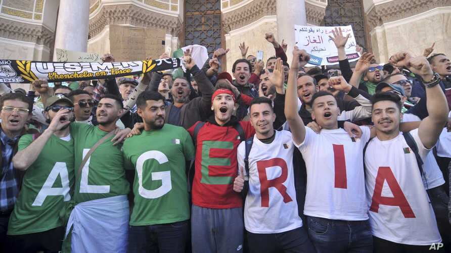 Algerians march during a protest in Algiers, Algeria, March 15, 2019.