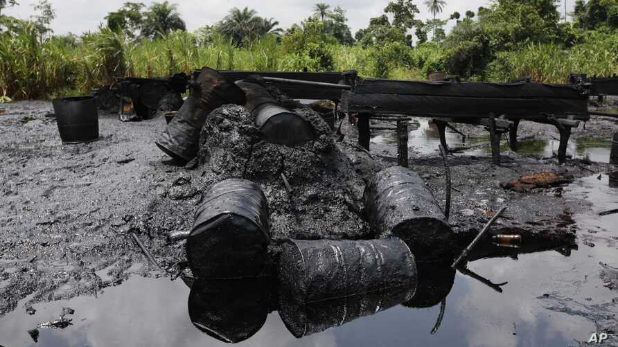 FILE- An abandoned illegal refinery is seen after it was raided by the Nigeria navy at the creeks of Bayelsa, Nigeria, May 18, 2013. At the time, the navy said it had destroyed 260 illegal refineries and burned 100,000 tons of contraband fuel to try