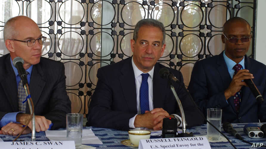 FILE - U.S. Special Envoy for the Great Lakes and the Democratic Republic of the Congo, Russel Feingold, center, talks to reporters in Kinshasa on the last leg of a 10-day visit to the country on January 28, 2014.