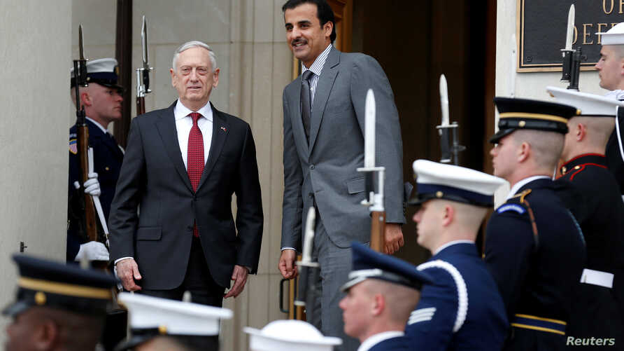 U.S. Secretary of Defense Jim Mattis stands with Qatari Emir Sheikh Tamim Bin Hamad Al-Thani during an Enhanced Honor Cordon at the Pentagon in Arlington, Virginia, near Washington, April 9, 2018.