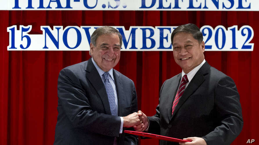 U.S. Secretary of Defense Leon Panetta, left, and his Thai counterpart Sukampol Suwannathat shake hands after signing the 2012 Joint Vision Statement for the Thai - US Defense Alliance during a joint press conference following meetings at the Ministr