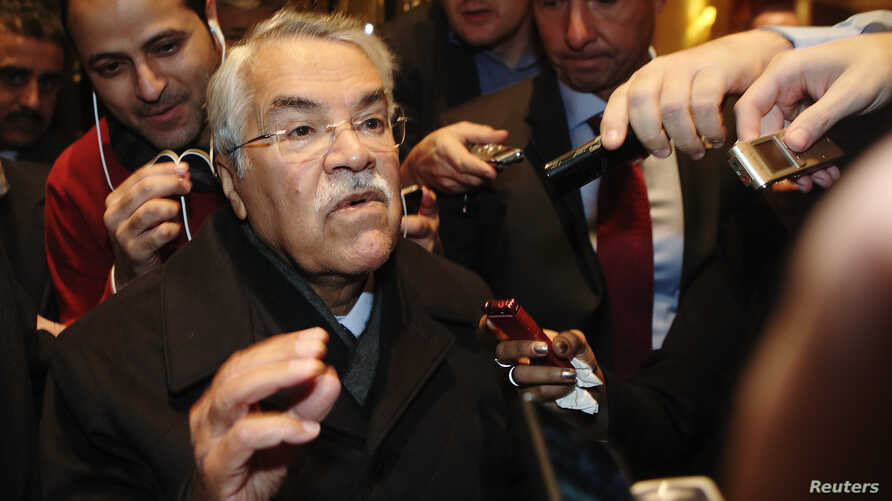 Saudi Arabian Oil Minister Ali al-Naimi gestures as he arrives at his hotel ahead of an OPEC meeting in Vienna Nov. 24, 2014.