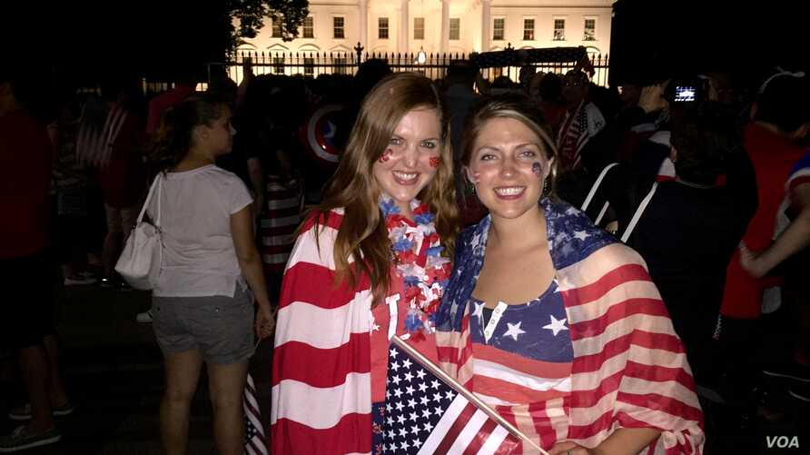 American soccer fans Laura Neff of California (left) and Kayli Westling of Wyoming (right) celebrate the U.S. women's national team World Cup final victory with the American Outlaws outside the White House, Sunday, July 5.