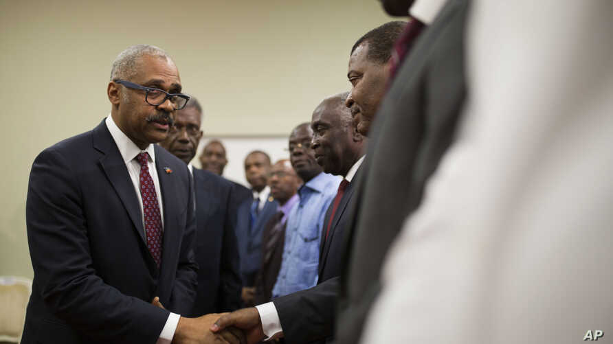 FILE - Haiti's newly nominated Prime Minister Dr. Jack Guy Lafontant greets Senate members after his speech at the national palace during the ceremony of his nomination as new prime minister in Port-au-Prince, Haiti.
