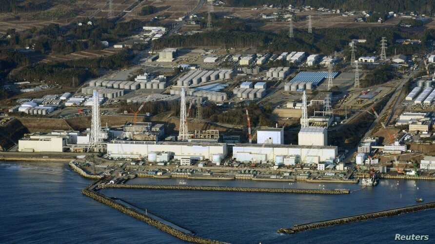 An aerial view shows Tokyo Electric Power Co.'s (TEPCO) tsunami-crippled Fukushima Daiichi nuclear power plant in Fukushima Prefecture, March 11, 2013.