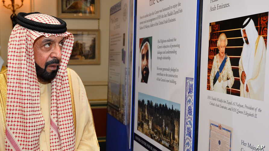 President of the United Arab Emirates, Sheikh Khalifa bin Zayed Al Nahyan looks at a photographic exhibition during his visit to Clarence House in central London on the second day of his State Visit to the UK, May 1, 2013.