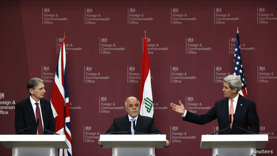 From left, Britain's Foreign Secretary Philip Hammond, Iraq's Prime Minister Haider al-Abadi and U.S. Secretary of State John Kerry attend a press conference at the Foreign and Commonwealth Office in London, Jan. 22, 2015.