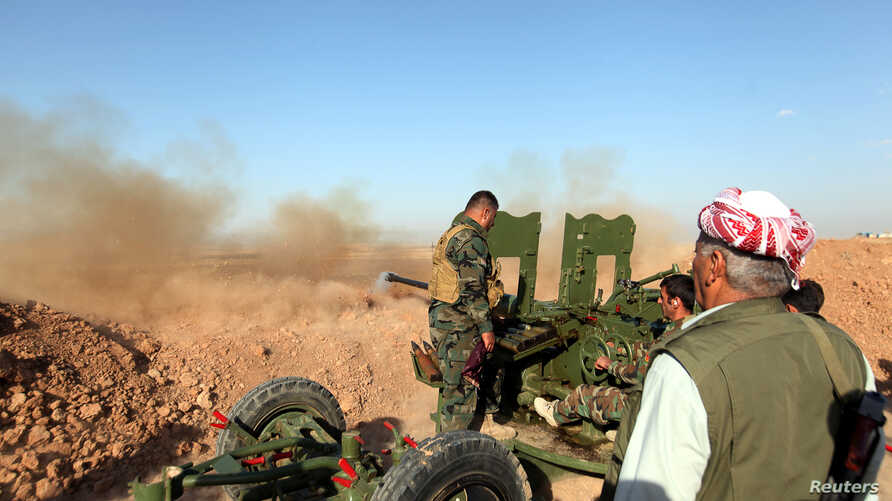 Kurdish Peshmerga forces fire a weapon during clashes with Islamic State militants in a village east of Mosul, Iraq, May 29, 2016.