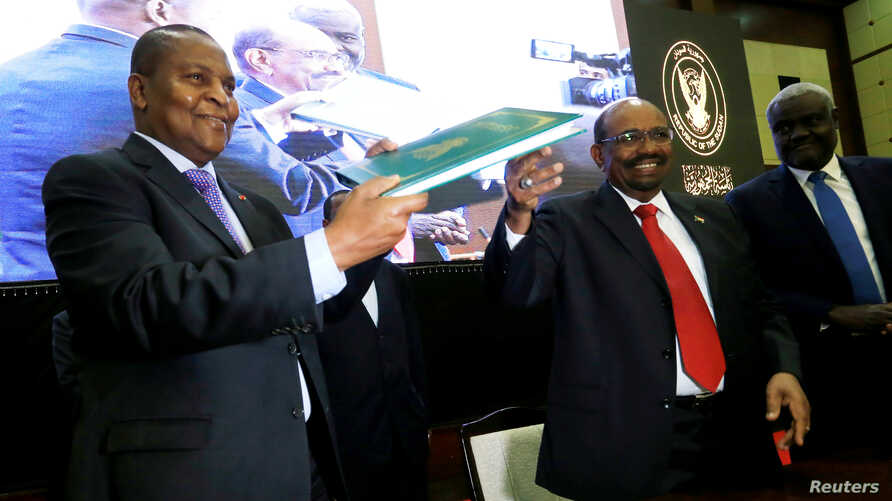 Central African Republic President Faustin-Archange Touadera is seen with Sudan's President Omar al-Bashir after signing a peace deal between the Central African Republic government and 14 armed groups following two weeks of talks in the Sudanese cap