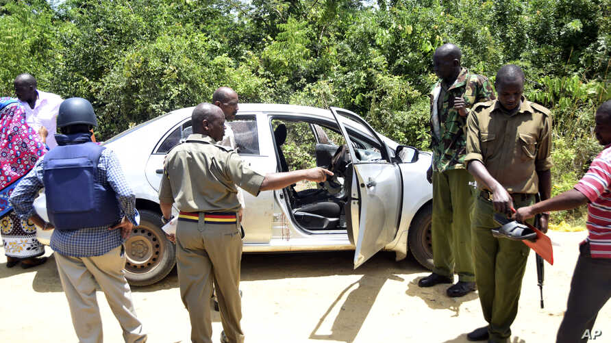 Armed security officers at the scene of shooting where two women were shot dead  in Ukunda town, south coast of Mombasa, Kenya, Oct. 10, 2017.