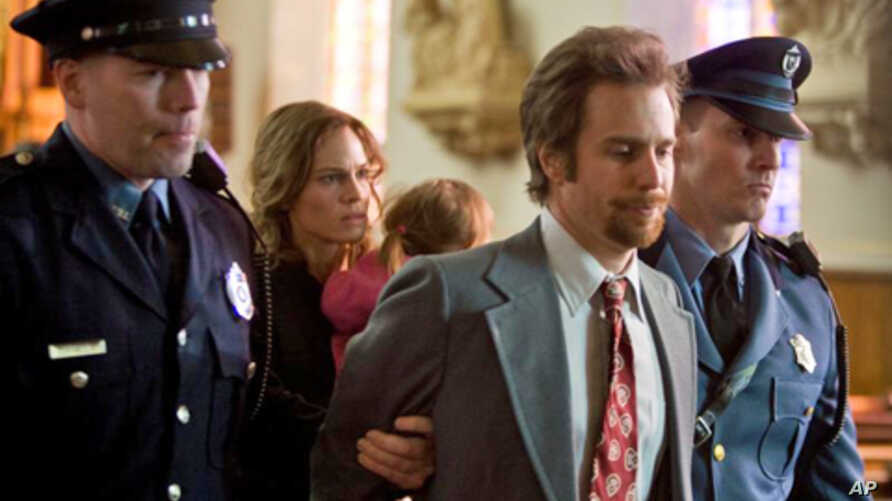 """Hilary Swank starring as Betty Anne Waters and Sam Rockwell as Kenny Waters in """"Conviction"""""""