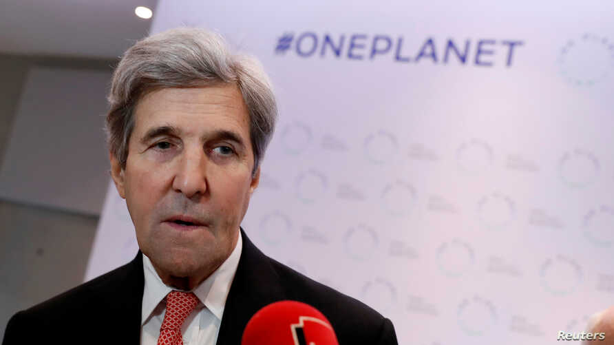 Former U.S. Secretary of State John Kerry talks to journalists during the One Planet Summit, near Paris, France, Dec. 12, 2017.