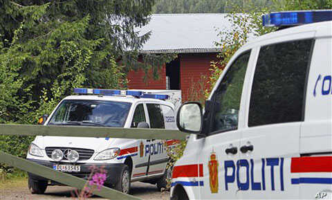 Norwegian police cars sit in front of the farm of Anders Behring Breivik, the suspect in the twin terror attacks that killed 76 people in Oslo and on Utoya island, in Asta, central Norway, July 28, 2011