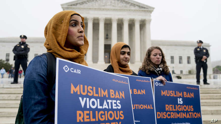 Zainab Chaudry, from left, Zainab Arain and Megan Fair with the Council on American-Islamic Relations, stand outside of the Supreme Court as the court hears arguments on President Donald Trump's ban on travelers from several mostly Muslim countries,