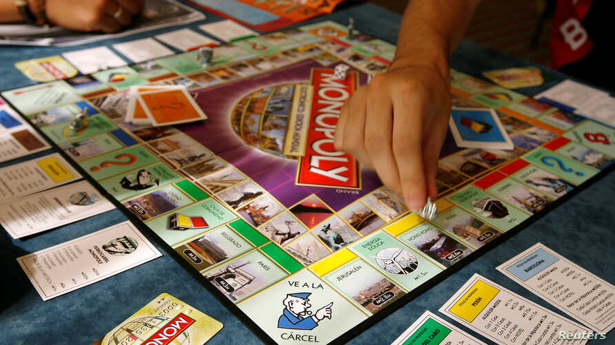 Players participate in a world record attempt by Monopoly enthusiasts across the world to set a Guinness world record for the largest simultaneous game of Monopoly, at a hotel in Madrid, Aug. 27, 2008.