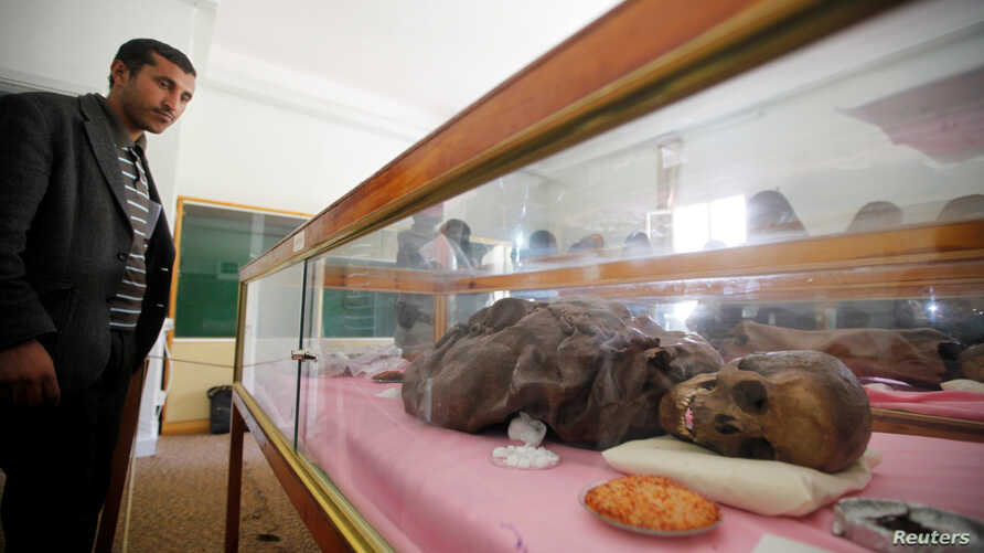 A man looks at a mummy dating back to an ancient Yemen era displayed at a museum at Sana'a University, in Sana'a, April 29, 2017.