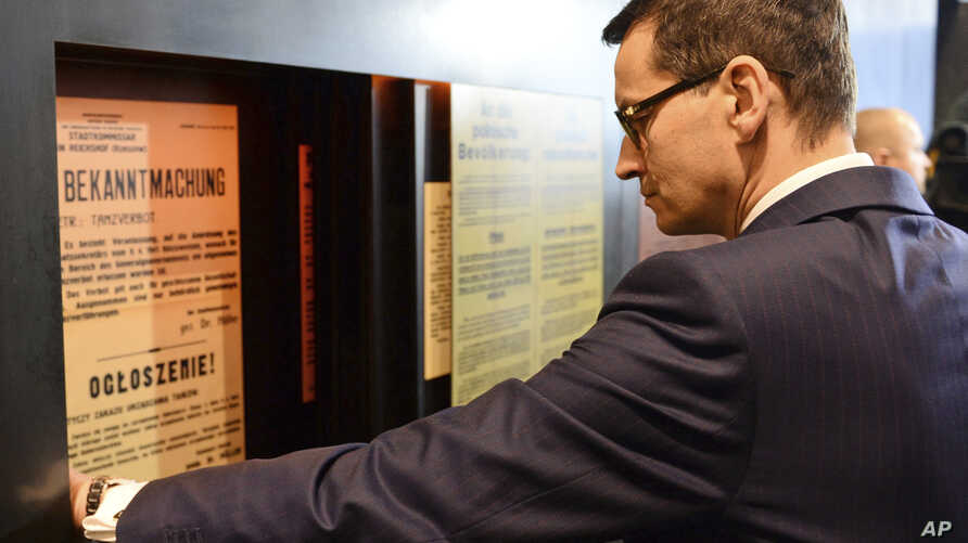 Polish Prime Minister Mateusz Morawiecki visits the Ulma Family Museum of Poles Who Saved Jews During WWII, in Markowa, Poland, Feb. 2, 2018. New legislation in Poland seeks to regulate speech regarding the Holocaust.