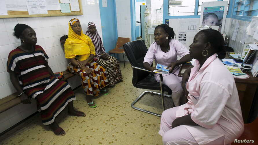 Midwives conduct consultations for pregnant women at the Treichville General Hospital during International Day of the Midwife in Abidjan, May 5, 2015.